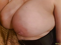 toying with her titties